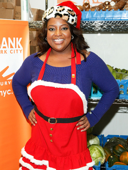 Celebrities Celebrate - Sherri Shepherd serves holiday meals to New Yorkers in need at the Food Bank for New York City's Community Kitchen of West Harlem on December 15, 2010 in New York City.